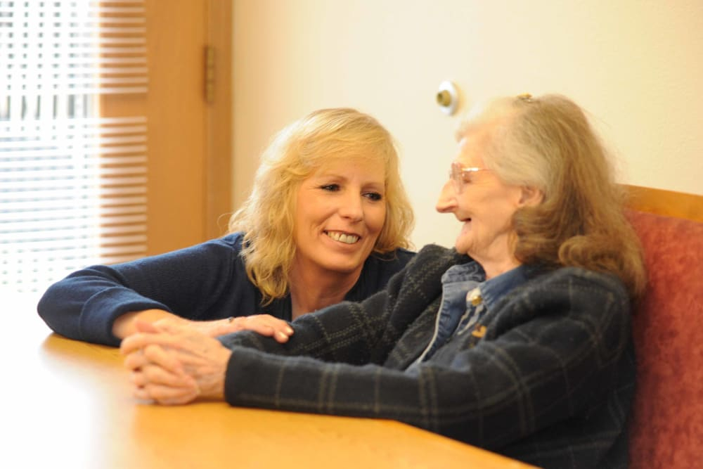 A senior sitting down with their caretaker at Chandler House in Yakima, Washington