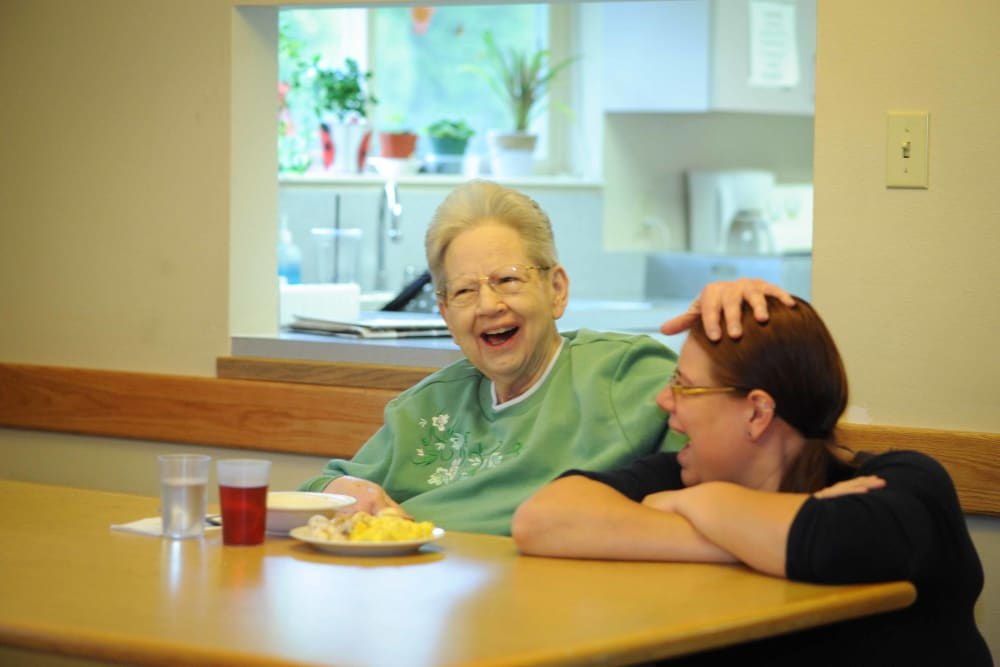 A patient having fun with their caretaker at Chandler House in Yakima, Washington