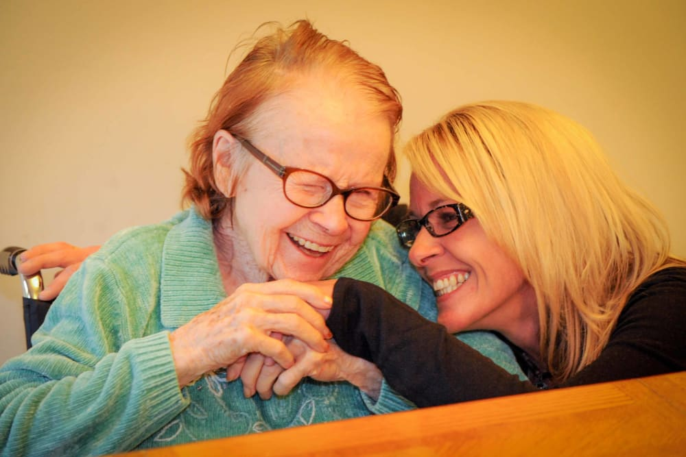 A caretaker hugging her patient at Chandler House in Yakima, Washington