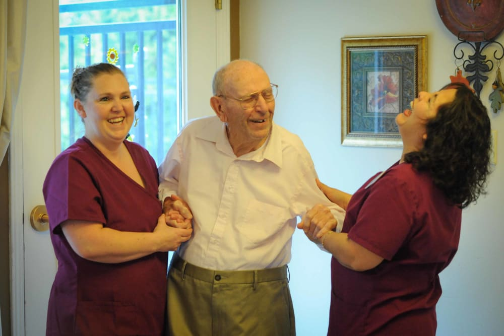 Two ladies laughing with a patient at Chandler House in Yakima, Washington
