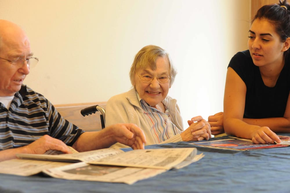A few seniors at Chandler House in Yakima, Washington reading the newspaper