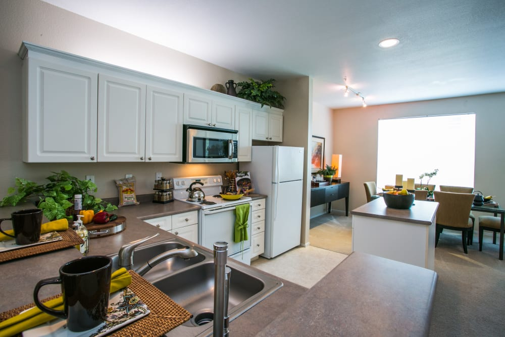 Fully equipped modern kitchen at The Colonnade Luxury Townhome Rentals in Hillsboro, Oregon