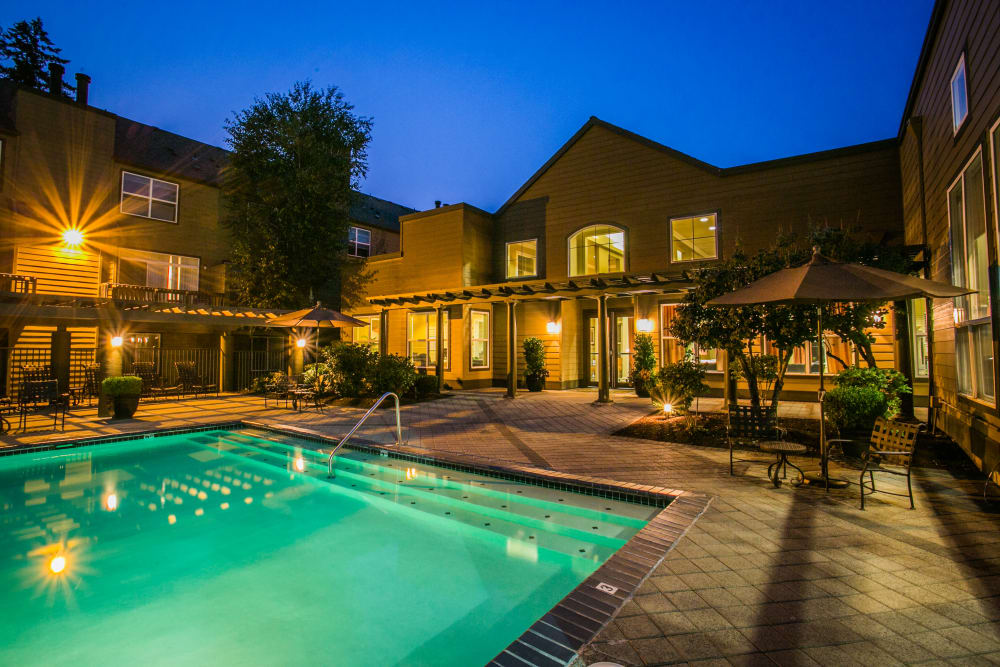 View of The Colonnade Luxury Townhome Rentals' swimming pool at night in Hillsboro, Oregon