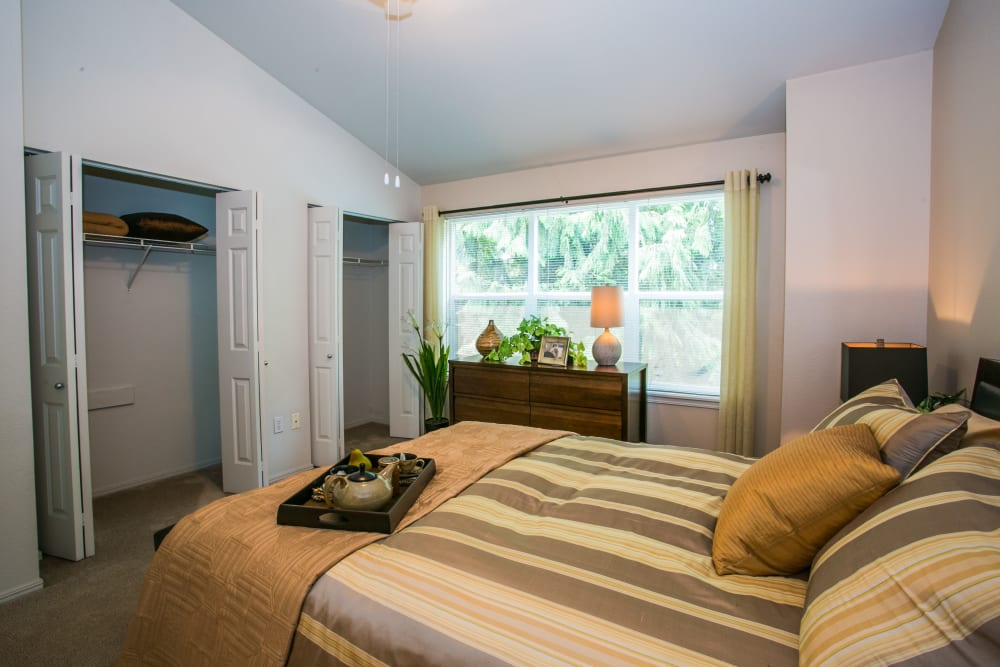 Bedroom with a spacious closet at The Colonnade Luxury Townhome Rentals in Hillsboro, Oregon