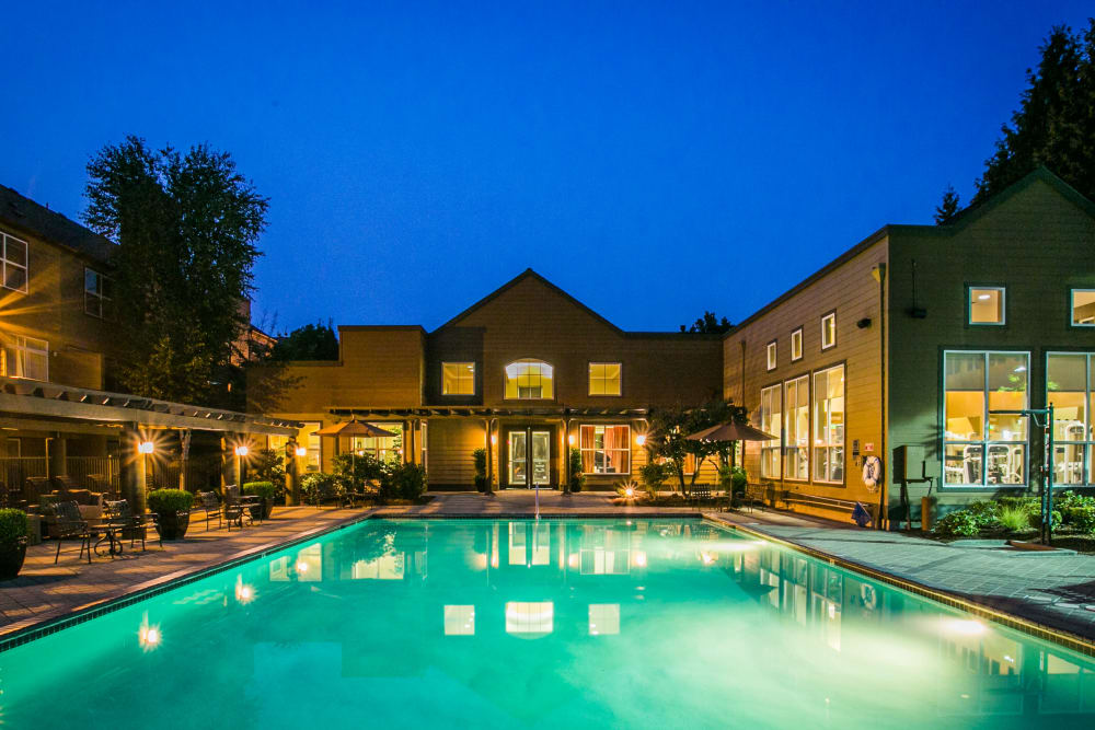 Swimming pool with lights at The Colonnade Luxury Townhome Rentals in Hillsboro, Oregon