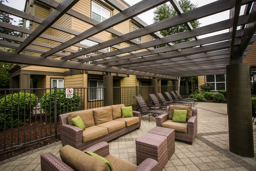 Poolside lounge with couches at The Colonnade Luxury Townhome Rentals in Hillsboro, Oregon