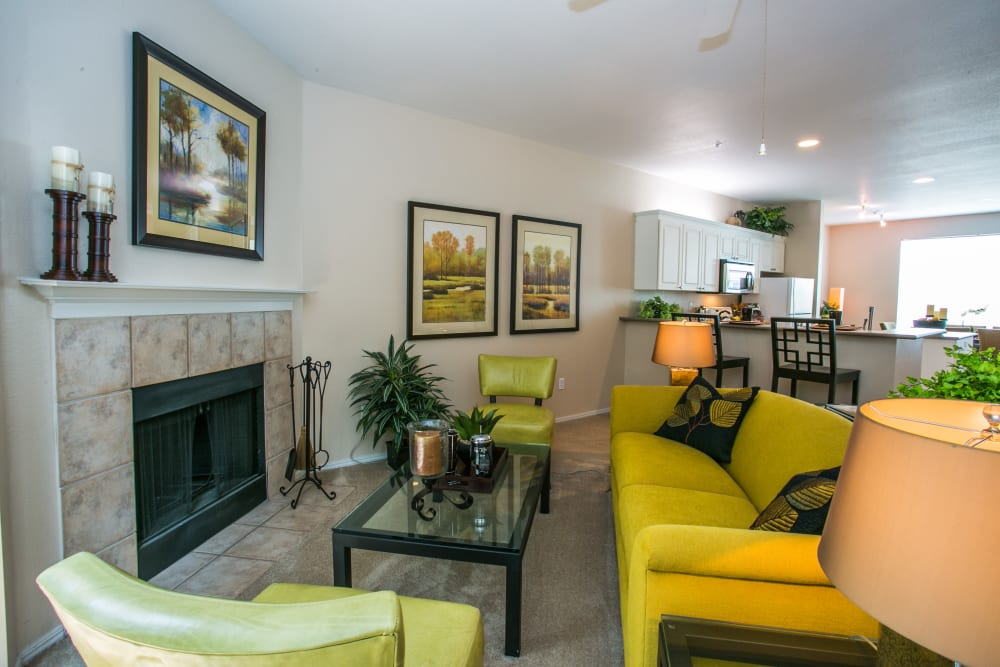 Spacious living room with a fireplace at The Colonnade Luxury Townhome Rentals in Hillsboro, Oregon