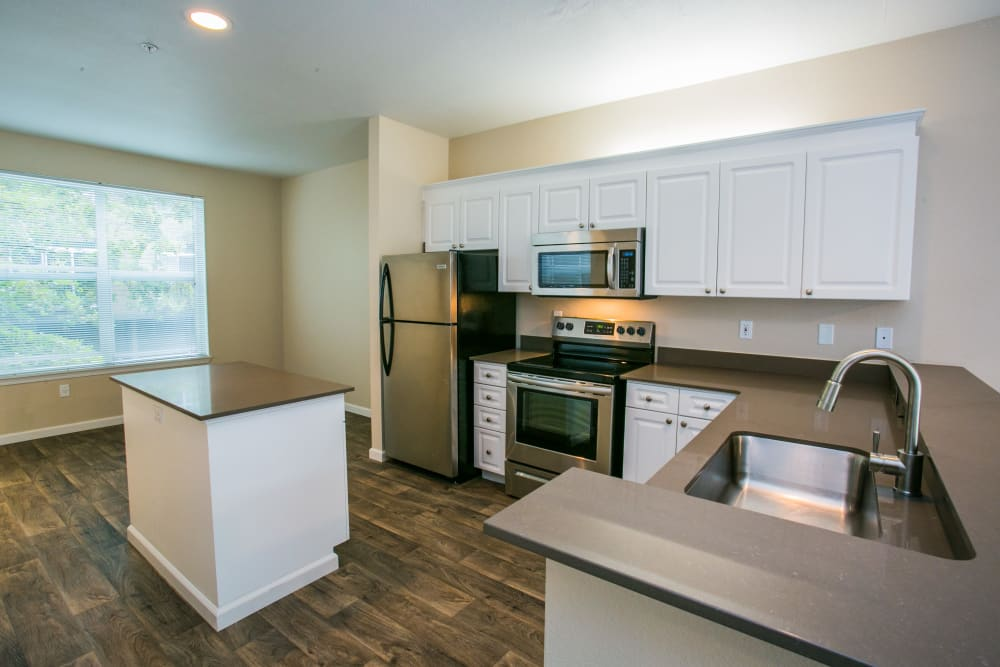 Modern, spacious kitchen at The Colonnade Luxury Townhome Rentals in Hillsboro, Oregon
