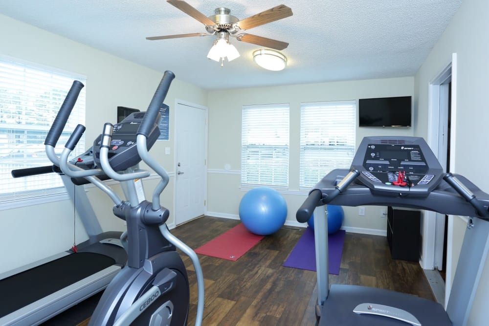 Fitness center with a ceiling fan at Homewood Heights in Birmingham, Alabama