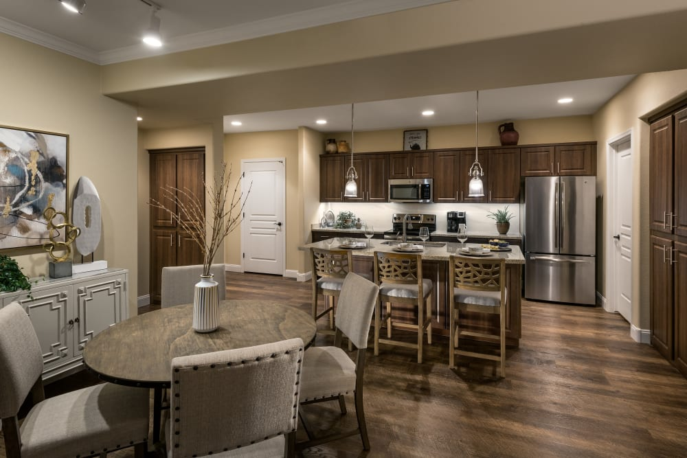 Beautiful open-concept floor plan with hardwood floors in model home at San Valencia in Chandler, Arizona