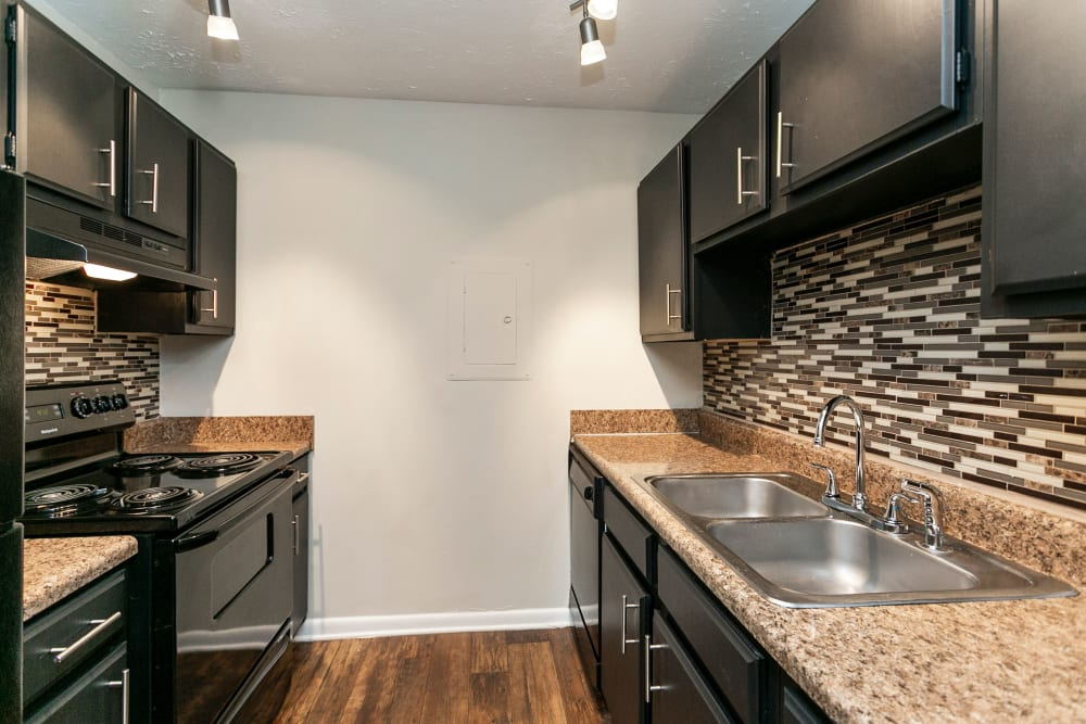 Kitchen with black appliances at Candlewood Apartments in Nashville, Tennessee
