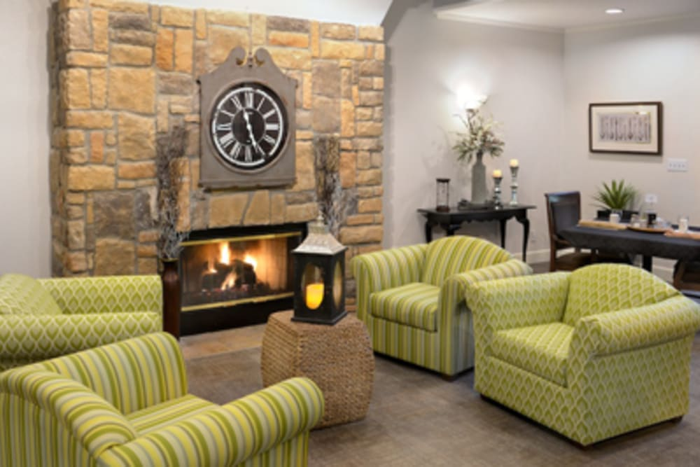 A few couches next to a fireplace at Peters Creek Retirement & Assisted Living in Redmond, Washington