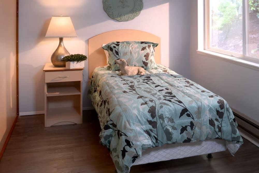 A comfy bed at Peters Creek Retirement & Assisted Living in Redmond, Washington