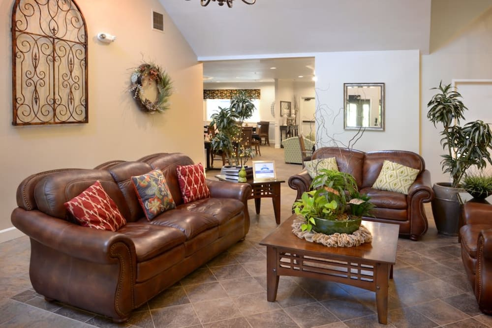 A nice leather couch and table at Peters Creek Retirement & Assisted Living in Redmond, Washington