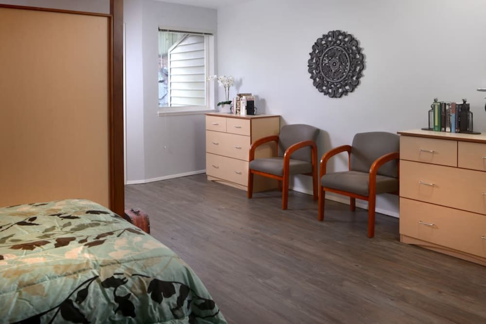 A bedroom at Peters Creek Retirement & Assisted Living in Redmond, Washington