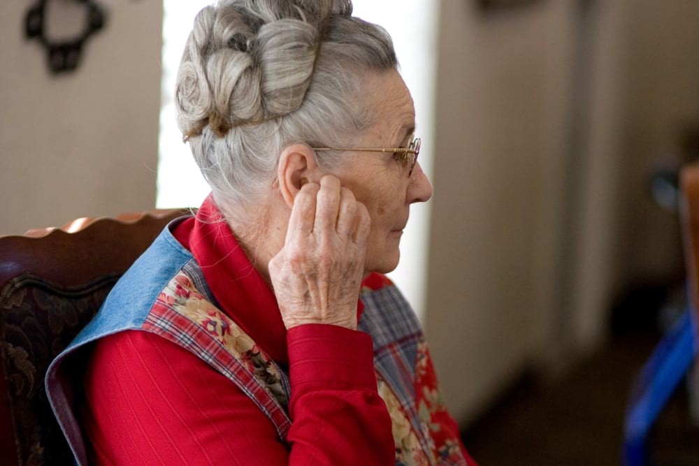Resident adjusting her earring at Parsons House La Porte in La Porte, Texas