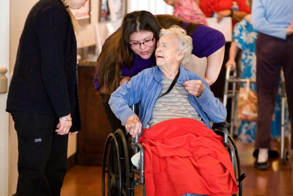 Happy resident in wheelchair at Parsons House La Porte in La Porte, Texas