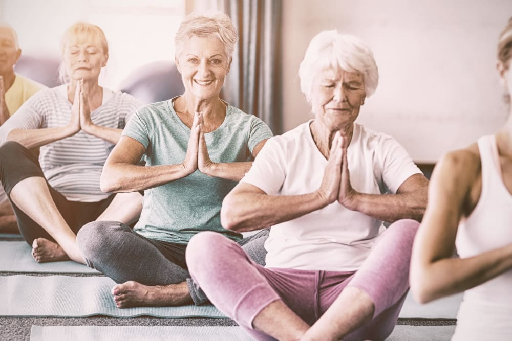 Relaxing yoga for residents of Keystone Place at Naples Preserve in Naples, Florida
