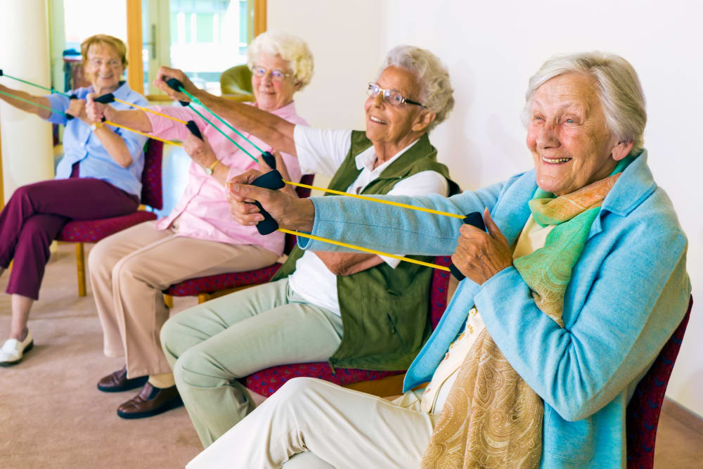 Residents enjoying elastic band exercise at The Keystones of Cedar Rapids in Cedar Rapids, Iowa