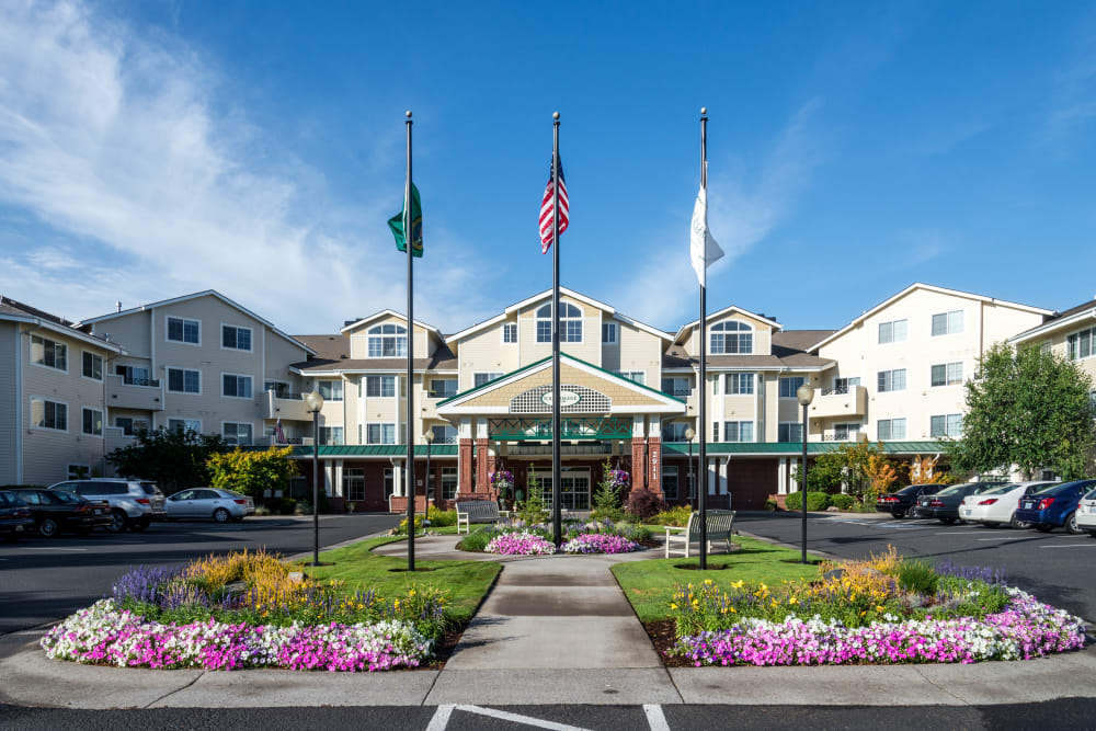 Flags in front of the main entrance at Touchmark at Fairway Village in Vancouver, Washington
