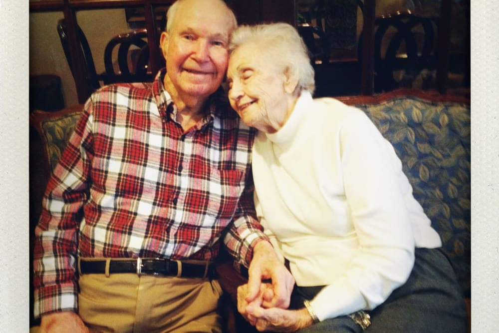 Happy resident couple snuggling at Parsons House Preston Hollow in Dallas, Texas