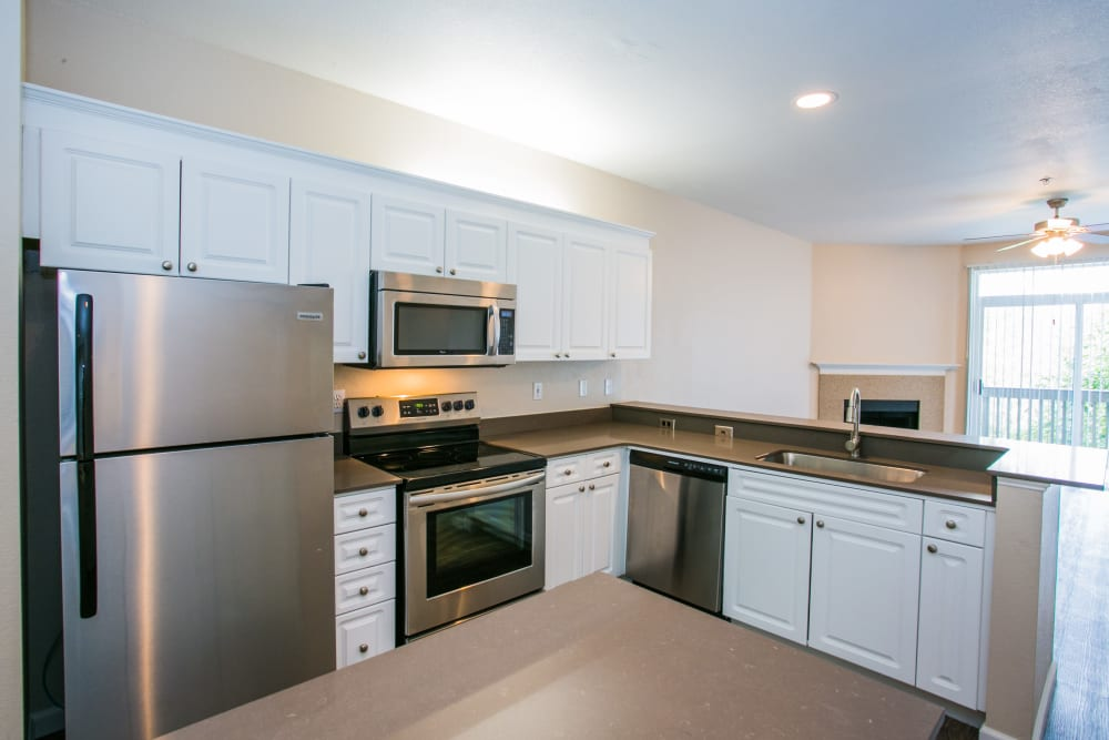 Kitchen with stainless steel appliance at The Colonnade Luxury Townhome Rentals in Hillsboro, Oregon