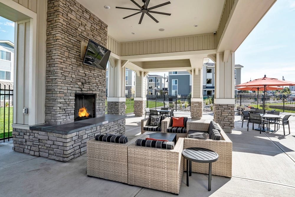 Outdoor lounge area with TV at The Overlook at Interquest in Colorado Springs, Colorado