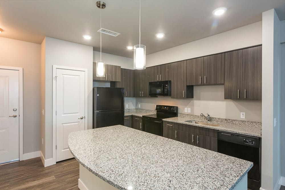 Kitchen with granite countertops at The Overlook at Interquest in Colorado Springs, Colorado