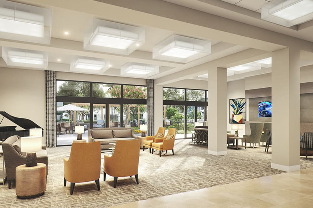 Living area with lots of chairs and tall windows at Sage Glendale in Glendale, California