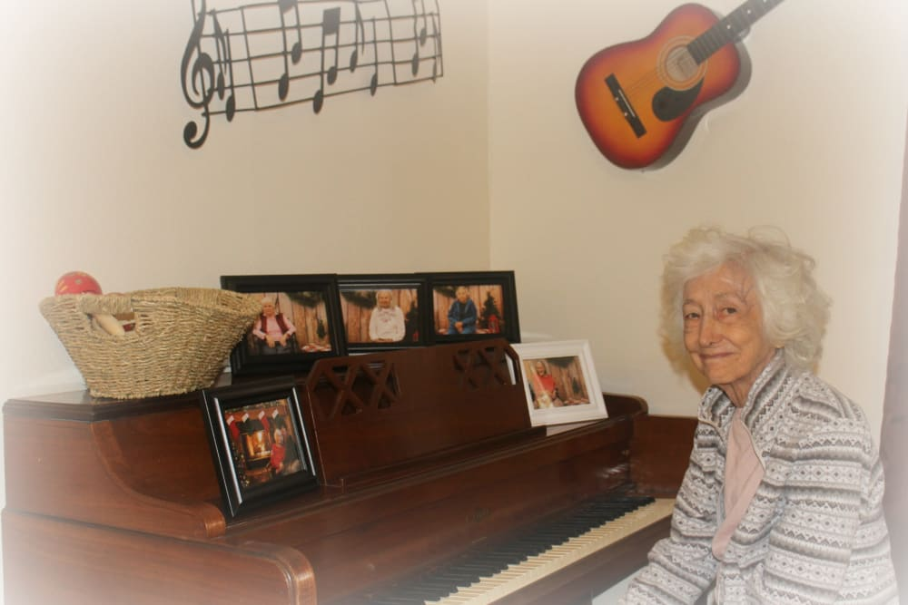 Resident playing piano at Desert Peaks Assisted Living and Memory Care