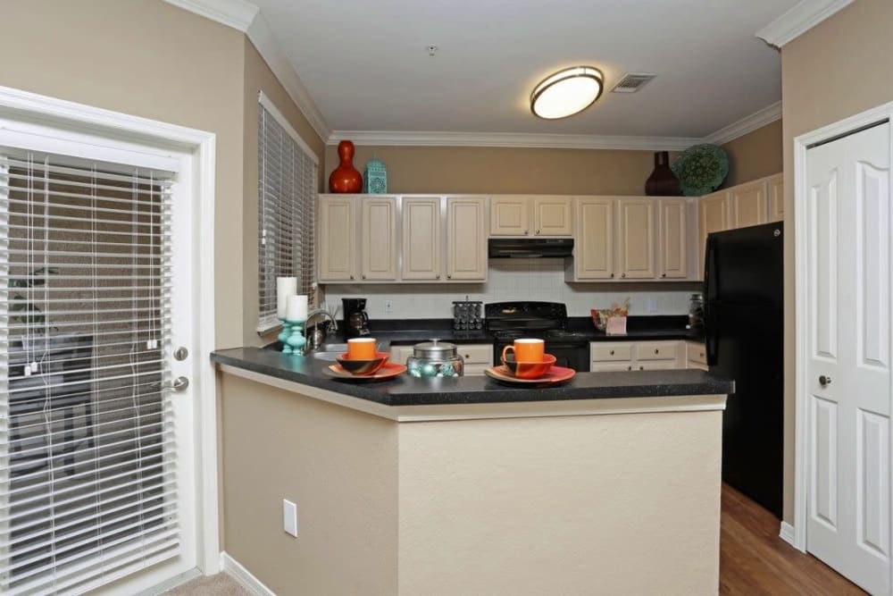 Kitchen overlooking the living at Amara at MetroWest in Orlando, Florida