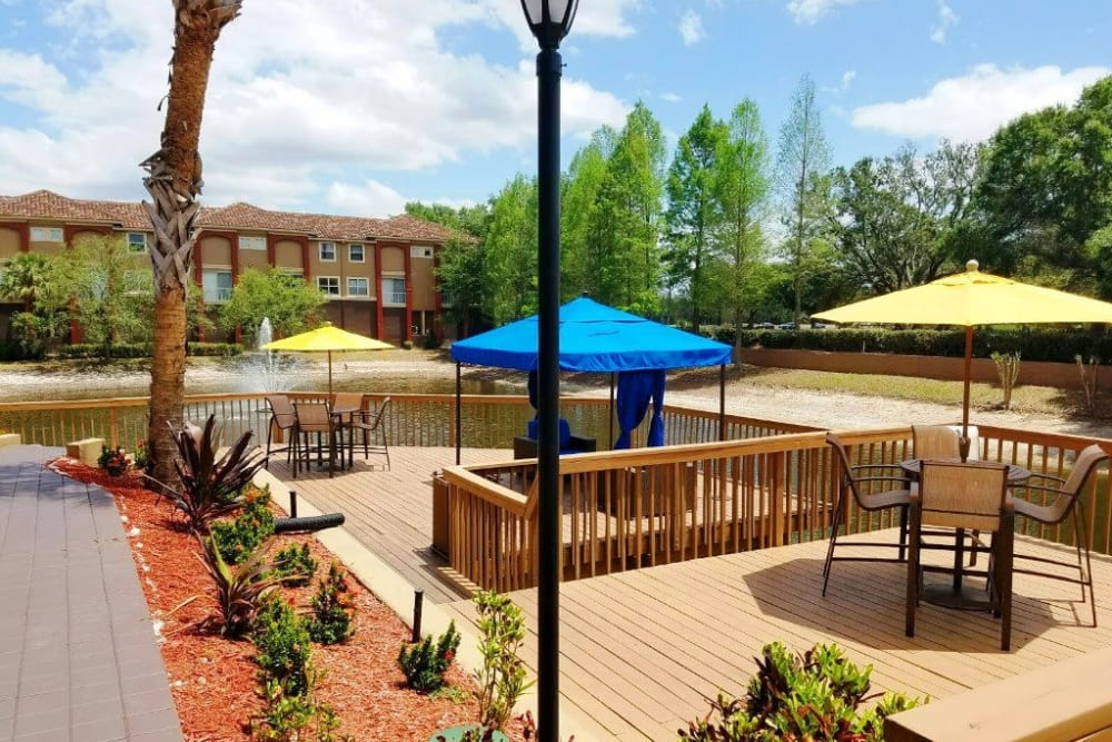 Covered seating for picnics by the pond at Amara at MetroWest in Orlando, Florida