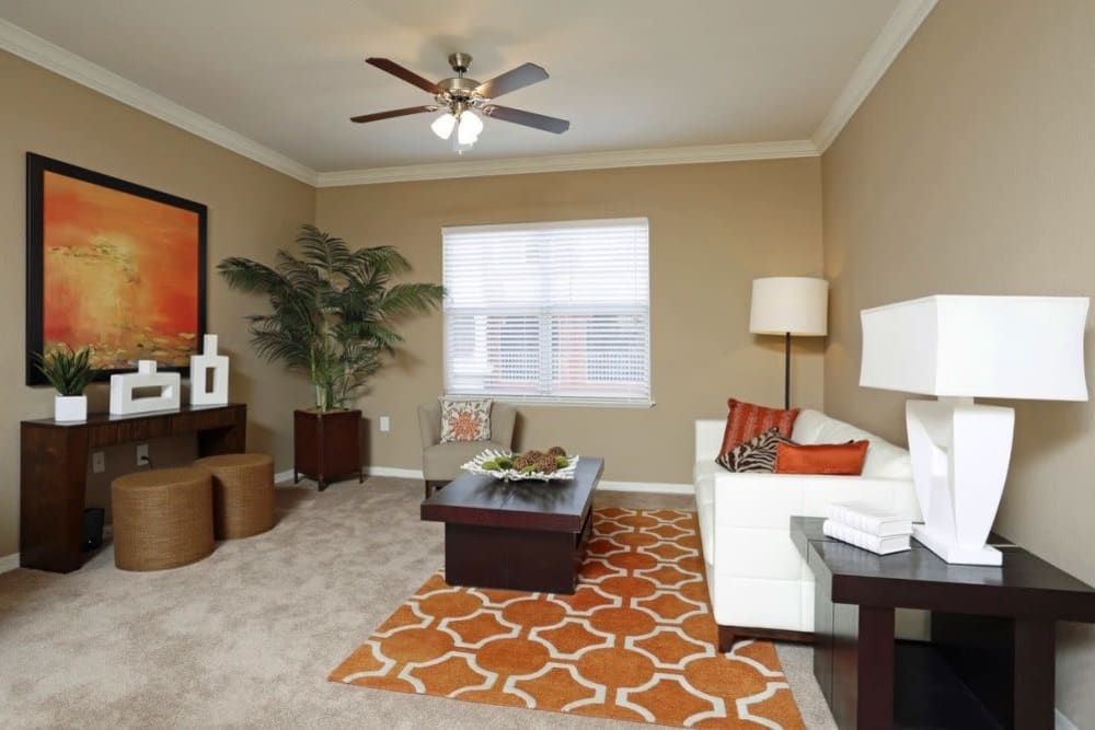 Spacious living room with ceiling fan at Amara at MetroWest in Orlando, Florida