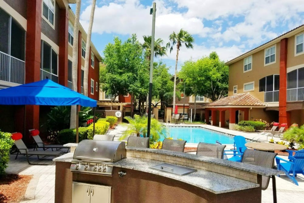 Poolside grilling station with bar seating at Amara at MetroWest in Orlando, Florida