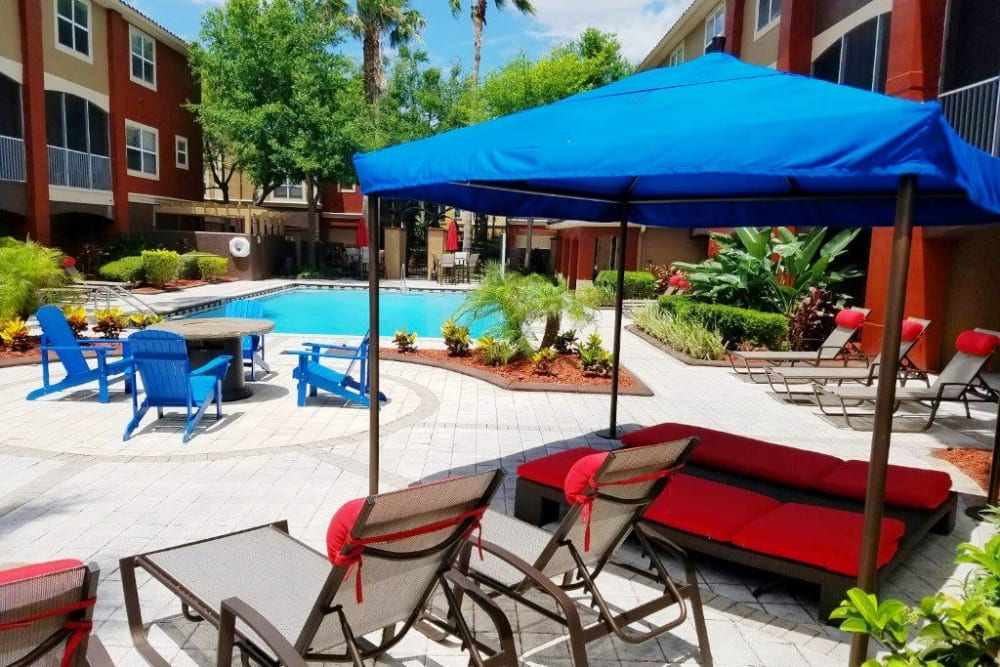 Poolside sundeck with plenty of seating for residents and their guests at Amara at MetroWest in Orlando, Florida