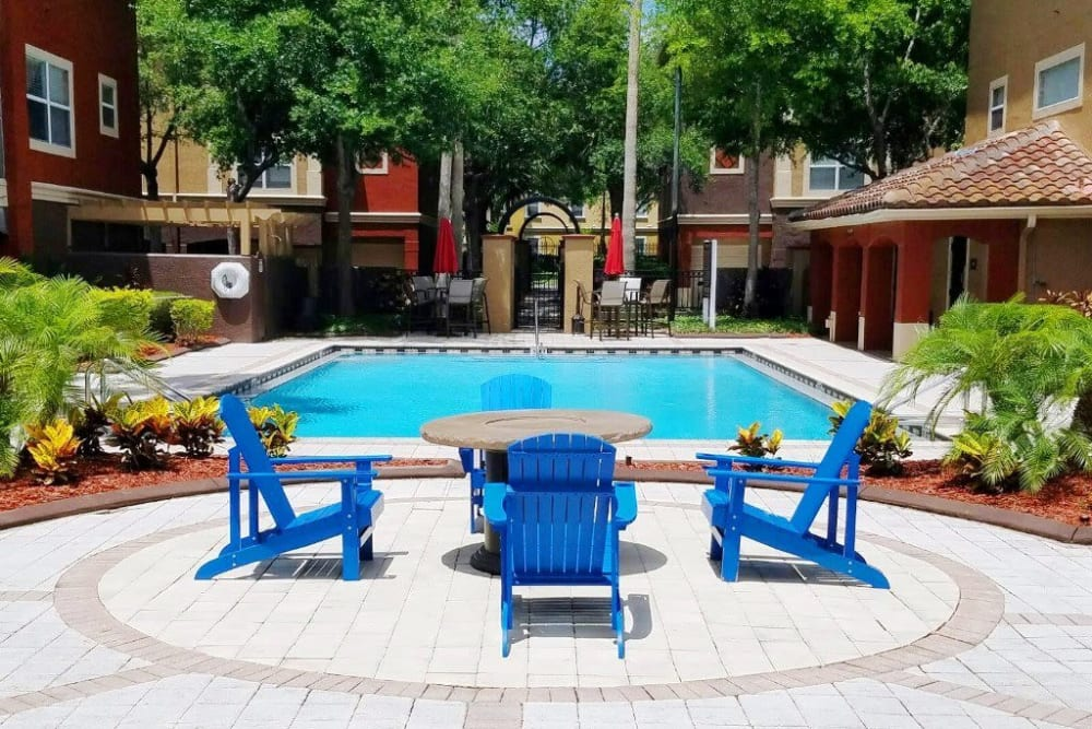 Poolside sundeck with lounge chairs for guests at Amara at MetroWest in Orlando, Florida