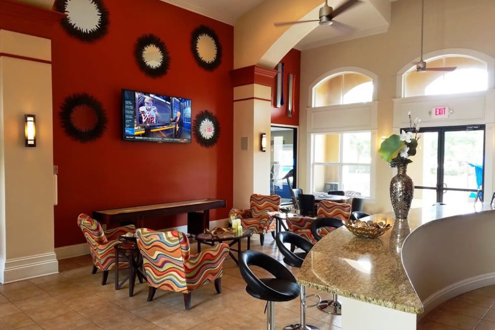 Contemporary resident clubhouse with plenty of seating at Amara at MetroWest in Orlando, Florida