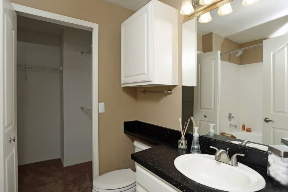 Bathroom with a large vanity at Amara at MetroWest in Orlando, Florida