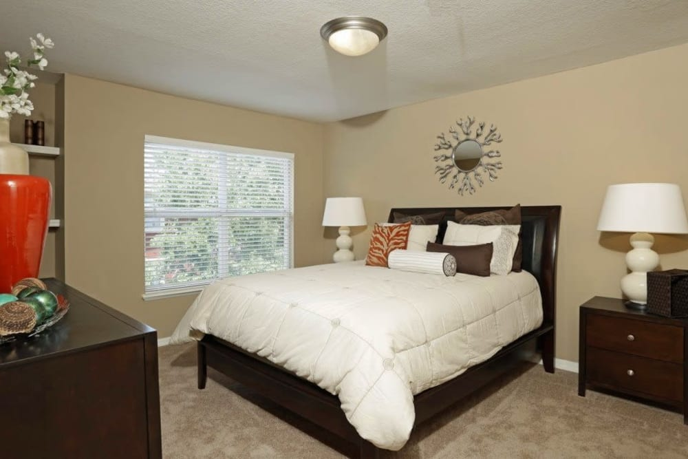 Spacious master bedroom with a large window for natural lighting at Amara at MetroWest in Orlando, Florida