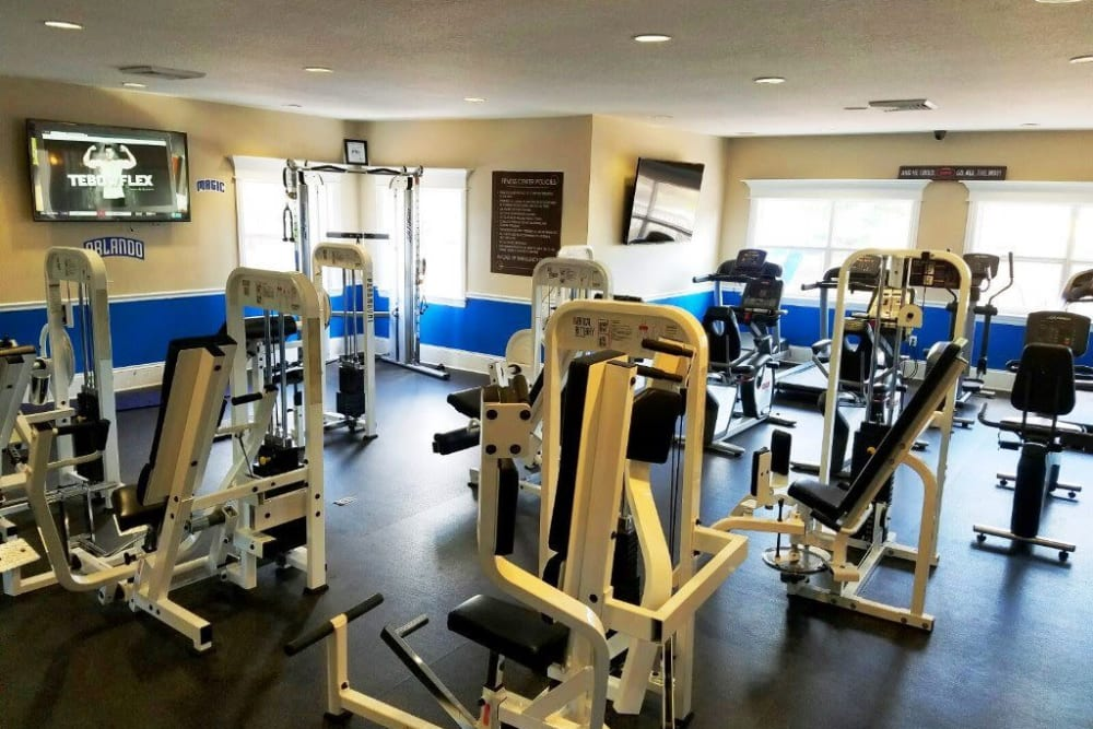 Fitness center with individual workout stations at Amara at MetroWest in Orlando, Florida