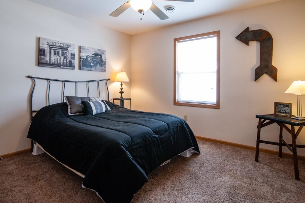 Bedroom with a ceiling fan at South Meadow in Ames, Iowa.