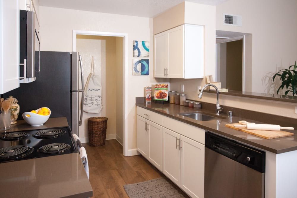 Kitchen with attached laundry room at The Villages