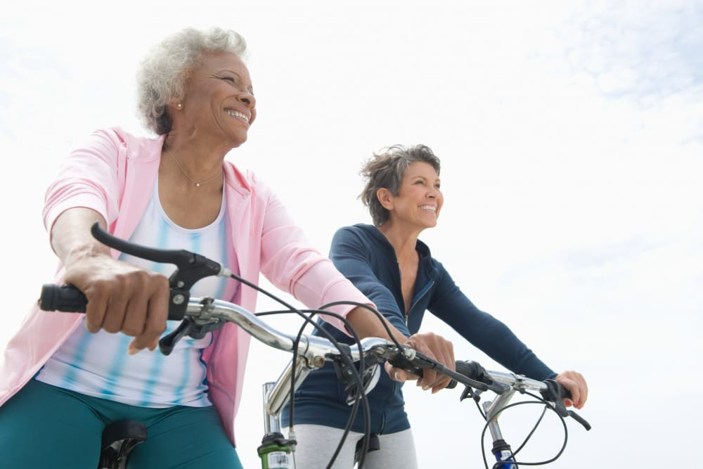 Residents riding bicycles together at The Heights at Columbia Knoll in Portland, Oregon