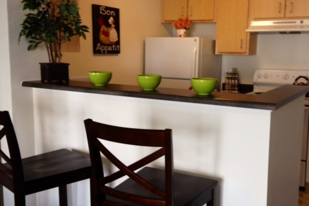 Kitchen bar area with stools at The Heights at Columbia Knoll in Portland, Oregon