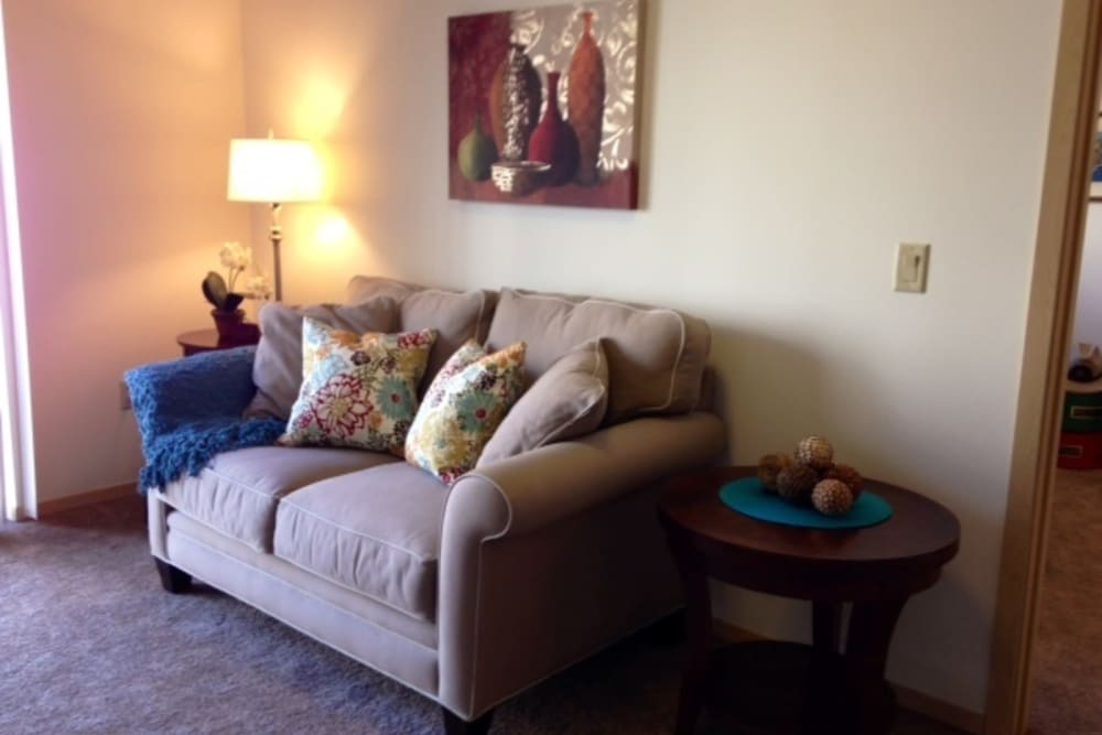 Living room space with a comfortable couch at The Heights at Columbia Knoll in Portland, Oregon