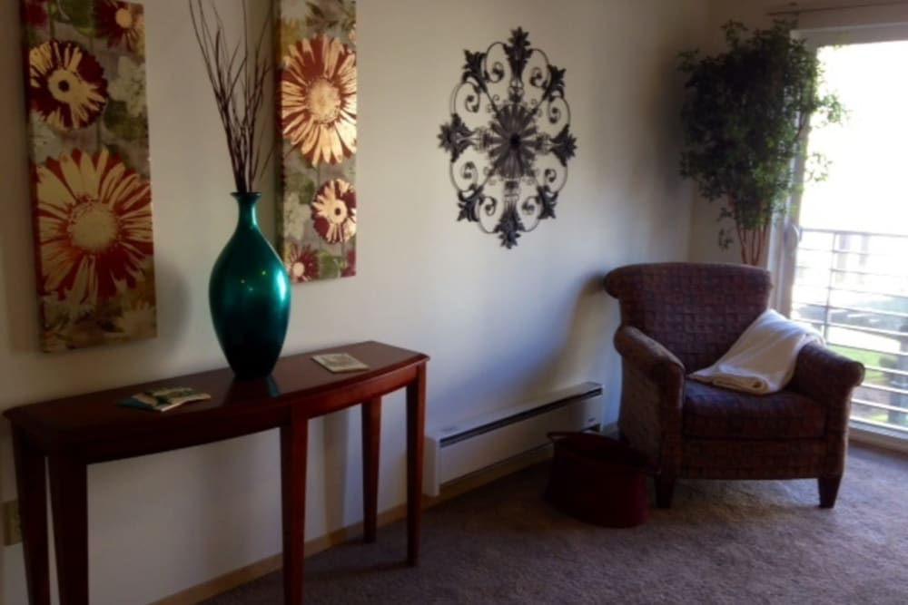 Living space with a table, chair and decorations at The Heights at Columbia Knoll in Portland, Oregon