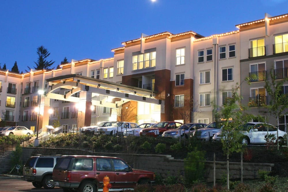 Front entrance with cars in the parking lot at The Heights at Columbia Knoll in Portland, Oregon