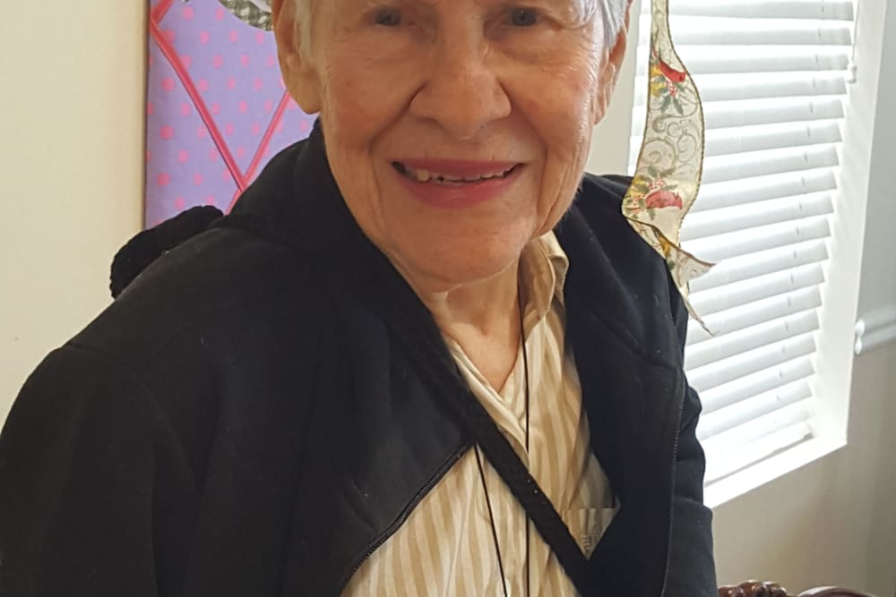 Resident smiling at the camera at Parsons House Frisco in Frisco, Texas
