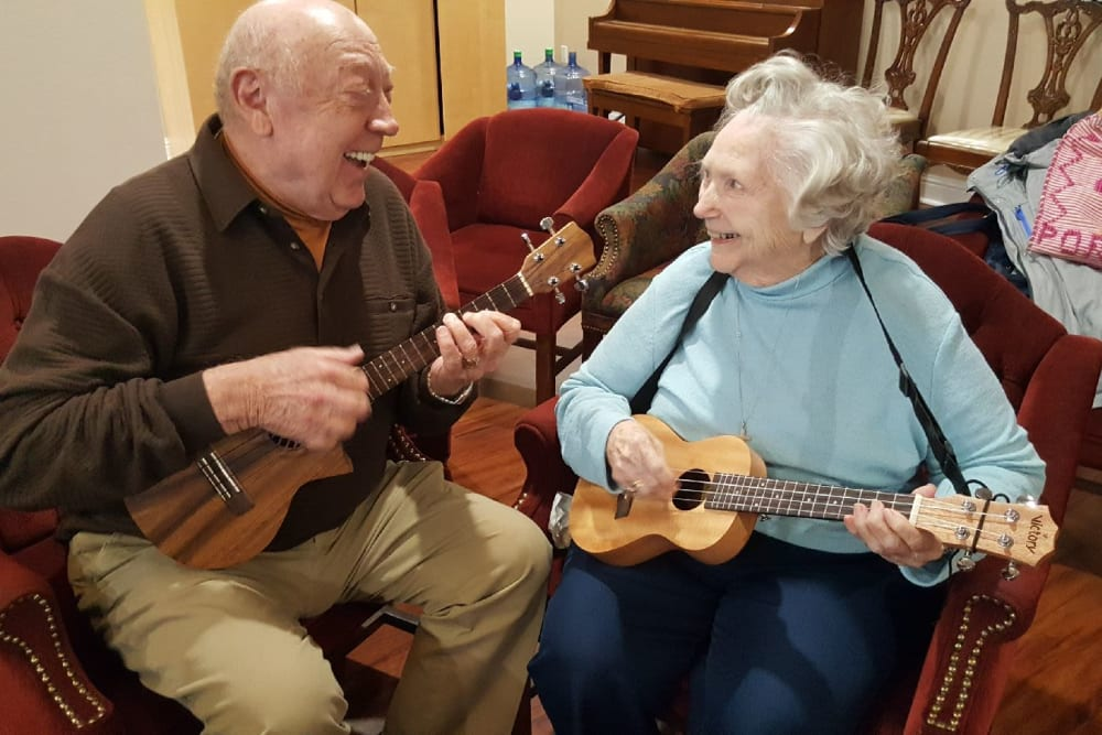 Two residents playing music together at Parsons House Frisco in Frisco, Texas
