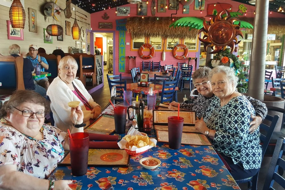 Residents at a restaurant at Parsons House Frisco in Frisco, Texas